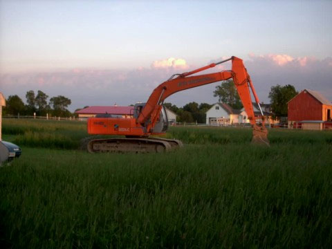 backhoe delivered to property the night before excavation began