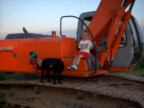 jacob and chucky up on the backhoe