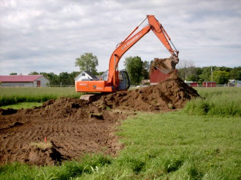 excavator removing topsoil